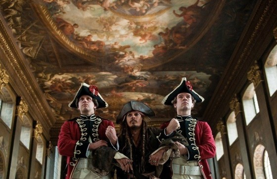Film still from Pirates of the Caribbean: On Stranger Tides showing Captain Jack Sparrow being dragged thorugh the Painted Hall
